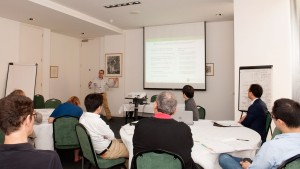 Gary Collins presenting to the group during the publication school