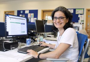 Patricia Logullo at her desk in the UK EQUATOR Centre office